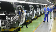 People work at assembly of cars Lada Kalina on conveyor Stock Footage