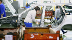 Woman assemble cars on conveyer of Avtovaz factory - stock footage