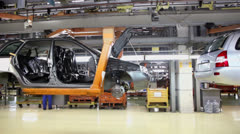 Lada Kalina hang at assembly conveyer of factory VAZ Stock Footage