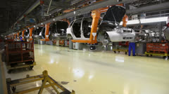 Conveyor transporter transfers unfinished cars at VAZ factory - stock footage