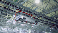 Stock Video Footage of Bodies of car Lada Kalina moves at conveyer of Avtovaz factory