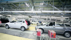 Row of Lada Kalina cars on conveyer at factory VAZ Stock Footage