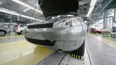 Car Lada Kalina slides on conveyer at factory VAZ Stock Footage