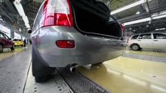 Rear of car Lada Kalina slides on conveyer at factory VAZ Stock Footage