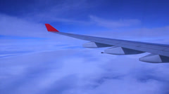 Airplane Seat Window. Sunny day. Blue sky and clouds. 5 Stock Footage