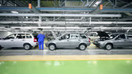 Stock Video Footage of Woman checks Lada Kalina cars which slide on conveyer