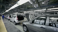 Stock Video Footage of Workers examine new Lada Kalina cars which slide on conveyer