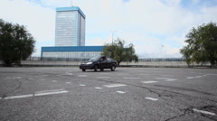Automobile Lada Granta rides by circle during test drive Stock Footage