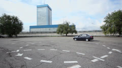 Car Lada Granta rides by circle during test drive at autodrome Stock Footage