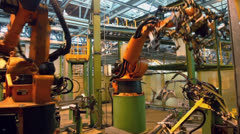 Stock Video Footage of Motion of robotics which weld car components at factory workshop