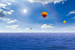 Colorful hot air balloon on the sea Stock Photos