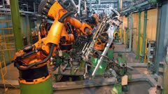 Stock Video Footage of Car parts conveyer with automatic robotics at factory