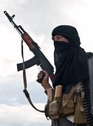 Muslim rebel with AK assault rifle - stock photo