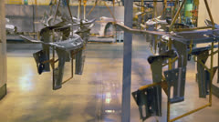 Car spares hangs on moving conveyor at factory workshop Stock Footage