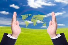 green world map in business man hand - stock photo
