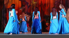 Dancing collective in blue suits dances on stage Stock Footage