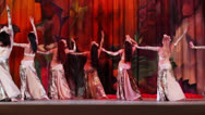 Stock Video Footage of Seven women collective in shiny dresses dances on stage