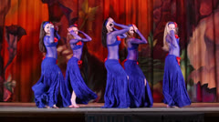 Five girls collective in navy blue suits dance on stage - stock footage