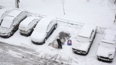 Person cleaning the snow from car at winter Stock Footage