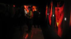 Visitors enjoying an evening at A. Ahmadov photo exhibition Red Stock Footage