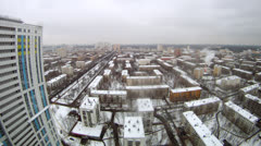 Wide aerial view of a snowy city on daylight Stock Footage
