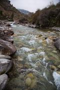 Tian Shan Mountain river in Kyrgyzstan - stock photo
