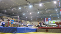 Athletes competing at parallel bar and judges at Stadium Dinamo Stock Footage