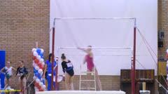 Young gymnasts warming up at parallel bars  at Stadium Dinamo Stock Footage