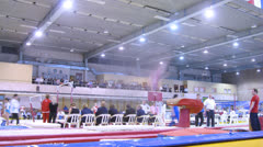 Gymnasts competing at parallel bars,  time lapse Stock Footage