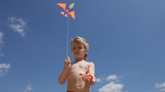 Little boy flying a kite Stock Footage