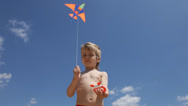 Stock Video Footage of little boy flying a kite
