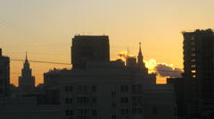 Beautiful aerial city view with sunset behind, time lapse Stock Footage