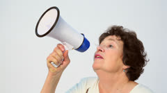 Old woman speaks in megaphone, isolated sideview closeup Stock Footage