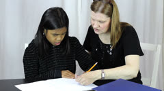 Mother Helps Asian Daughter With Homework Stock Footage