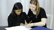 Stock Video Footage of Mother Helps Asian Daughter With Homework