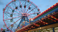 Ferris wheel amusement park at night in Coney Island - stock footage