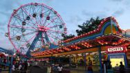 Stock Video Footage of Ferris wheel amusement park at night in Coney Island