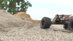 Remote control car kicking up dust slow motion - stock footage