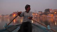 Boatman at dawn in India Varanasi Stock Footage