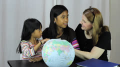 Homeschool Teacher Uses Globe To Explain Geography Lesson Stock Footage
