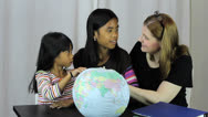 Stock Video Footage of Homeschool Teacher Uses Globe To Explain Geography Lesson