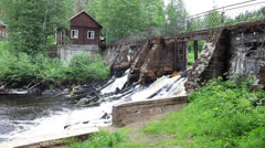 Old wooden house on demolished dam on river Stock Footage