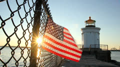 American Flag Blowing in the Breeze in the Early Morning, Bug Lighthouse Stock Footage