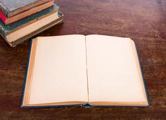 Open old vintage book on wooden table Stock Photos