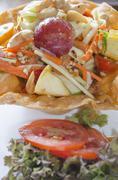 Angel payaya salad in crisp flower bowl Stock Photos