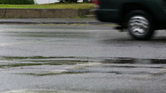 Cars Drive in the Rain on Busy Street Stock Footage