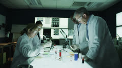 Multi ethnic medical research team working in the lab Stock Footage