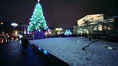 People walk by square with christmas tree near Bolshoi theater Stock Footage
