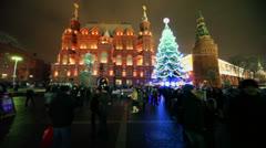 Tourists walk near Christmas tree on Maneznaya square Stock Footage