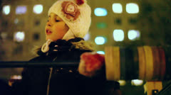 Little girl in warm clothes speaks on playground at winter Stock Footage